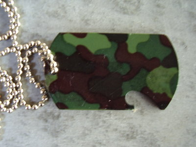 Dog tag met flesopener.